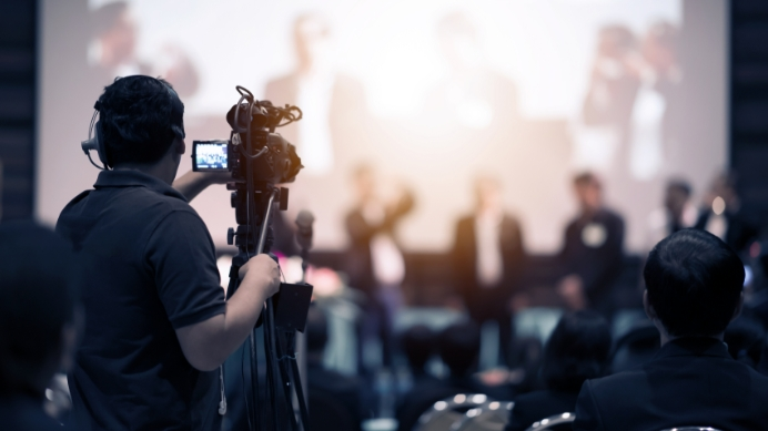 video-camera-operator-working-with-his-equipment-indoor-event